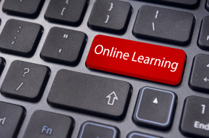 online learning concepts, with message on enter key of keyboard.